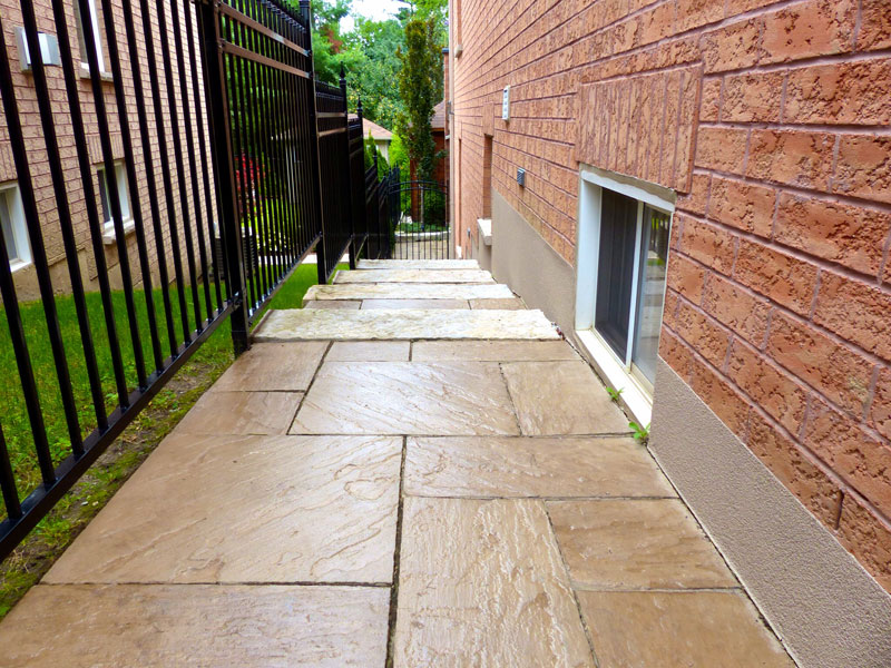 Pressure washing interlocking stone walkways