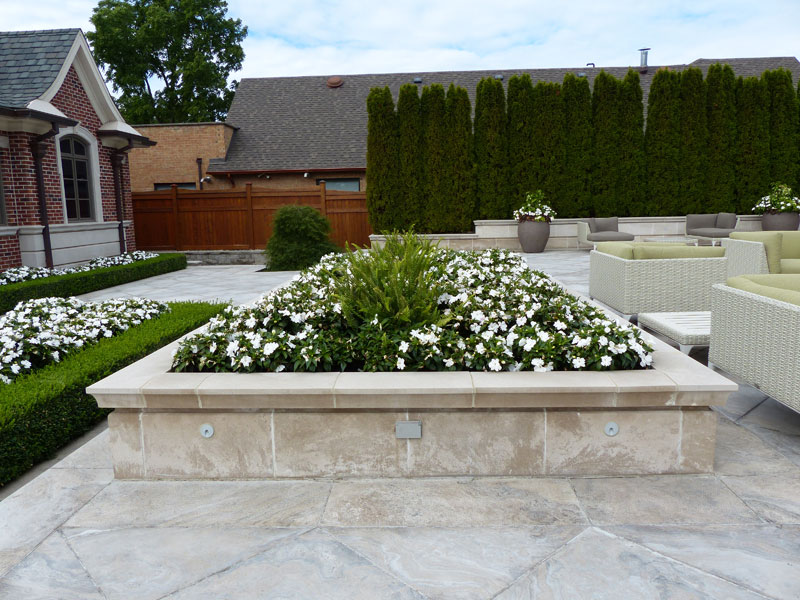 Retaining walls, interlock stones, concrete work, planters, urns